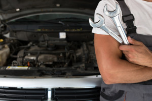 Auto Mechanic with Car